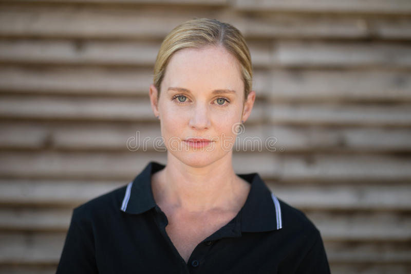 Portrait of serious female jockey royalty free stock image