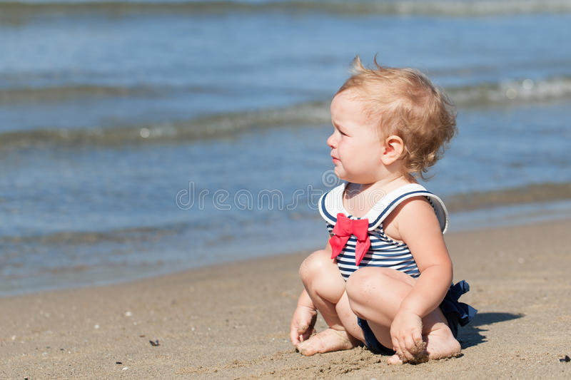 Portrait of serious girl in swimsuit on beach stock photos