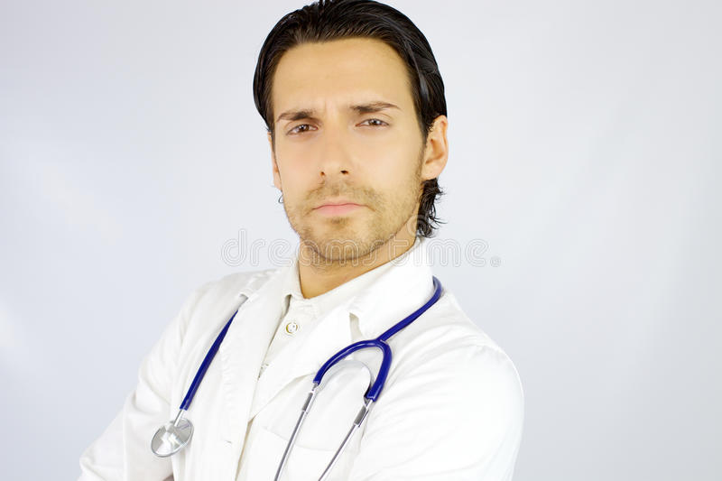 Portrait of serious handsome american doctor looking camera stock images
