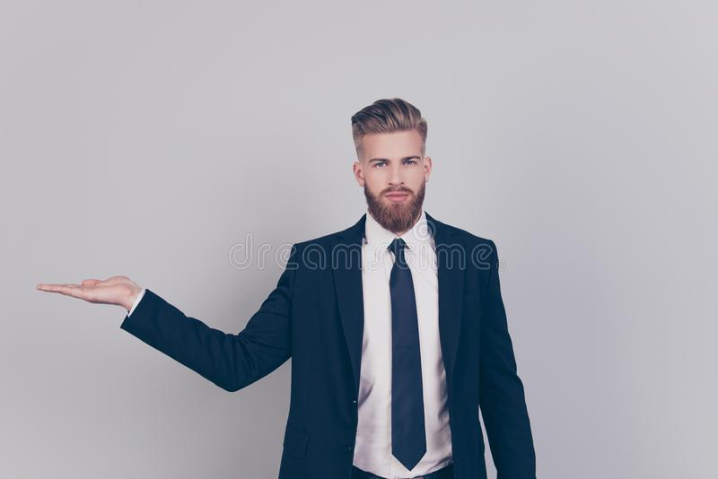 Portrait of serious handsome confident strict professional expert with red beard wearing black formal outfit dark blazer stock photography