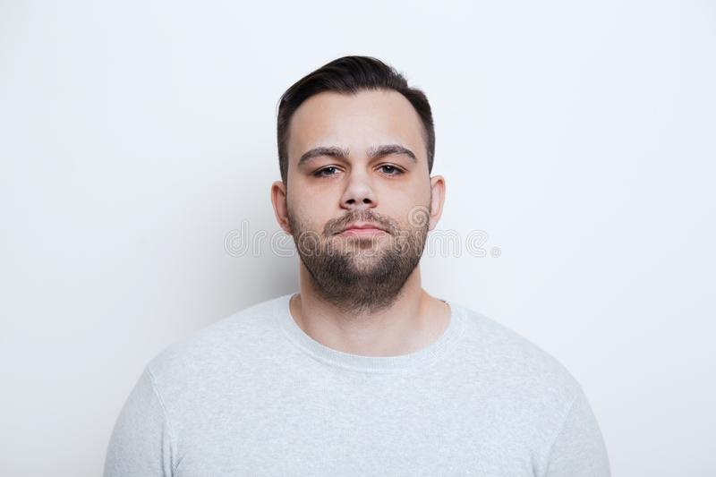 Portrait of serious man over white studio background royalty free stock photos