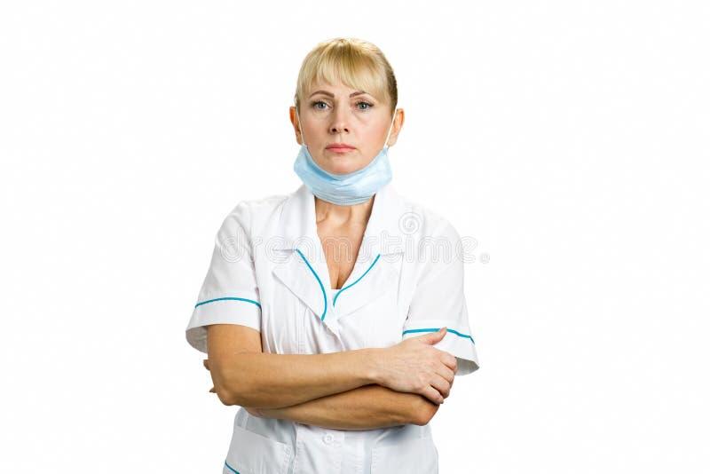 Portrait of serious mature nurse. stock images