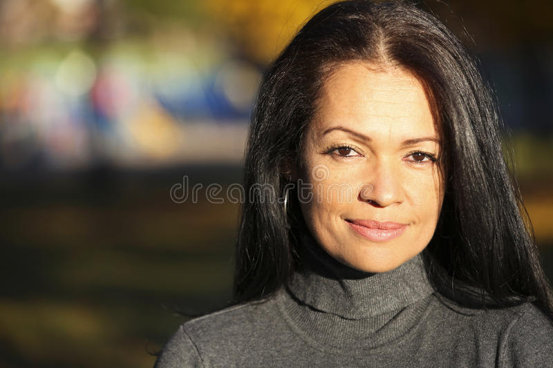 Portrait Of A Serious Mature Woman Looking At The Camera stock images