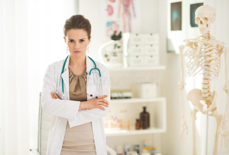 Portrait of serious medical doctor woman royalty free stock images