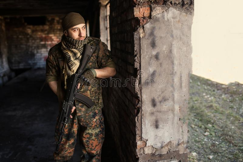 The Arab soldier with the AK-47 Kalashnikov assault rifle stock photo