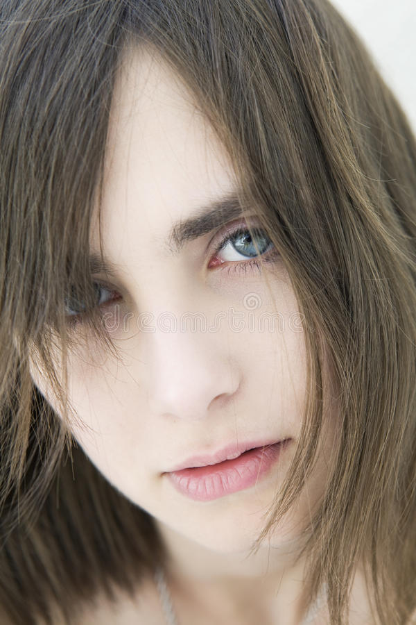 Portrait of serious sad girl with blue eyes royalty free stock images
