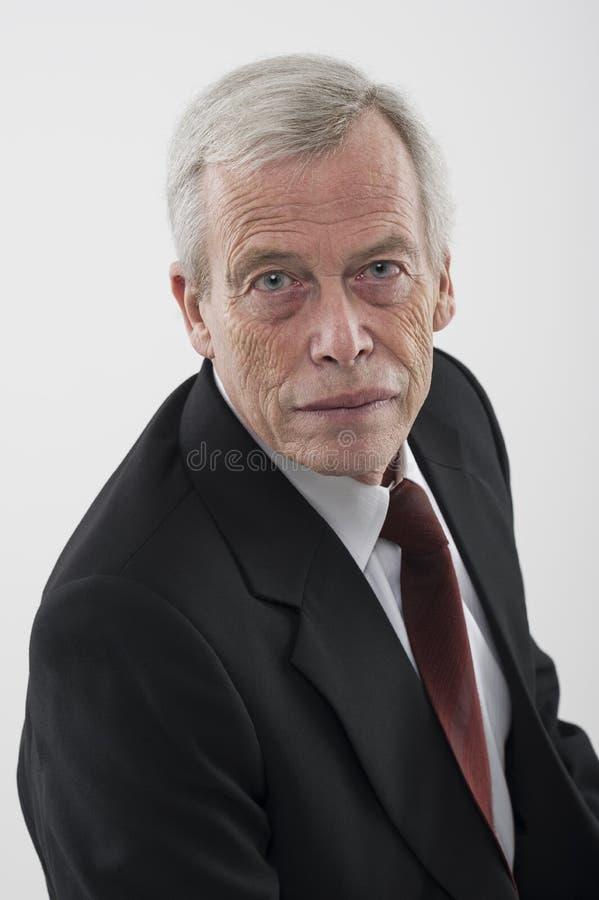 Portrait of a serious senior man stock images