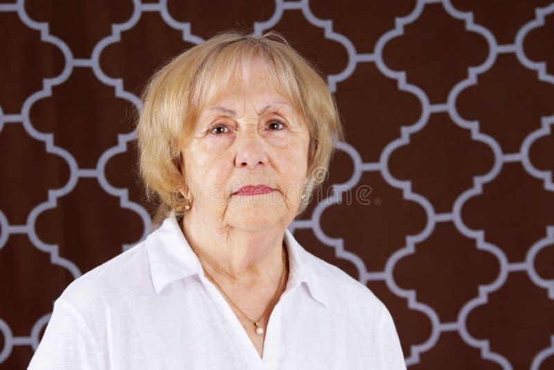 Portrait of serious senior woman royalty free stock photo