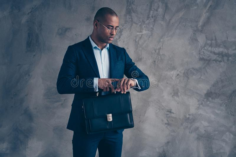 Portrait of serious worried gentleman collar client have briefing meet deadline look watch take diplomat expert concept. Wear modern outfit jacket short hair stock photography