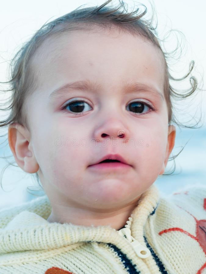 portrait of a 2 year old girl on the background the sea royalty free stock images