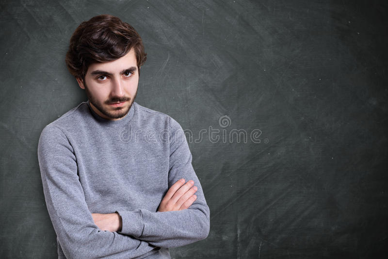 A portrait of serious young bearded guy with stylish hairstyle d royalty free stock photography