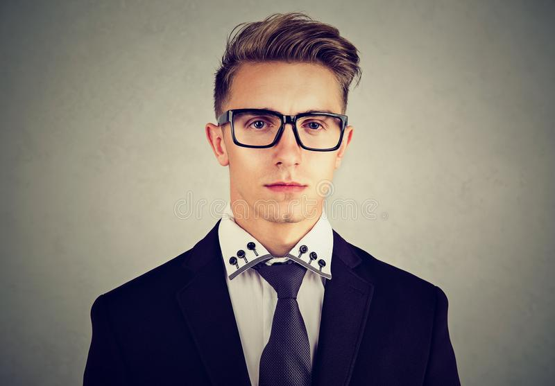 Portrait of a serious young business man on gray background stock photo