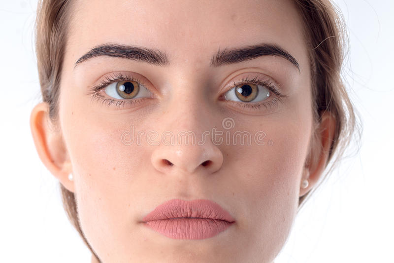 Portrait of serious young girl without makeup close-up royalty free stock photos