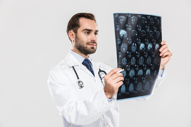 Portrait of serious young medical doctor working in hospital and holding X-ray scan stock photos