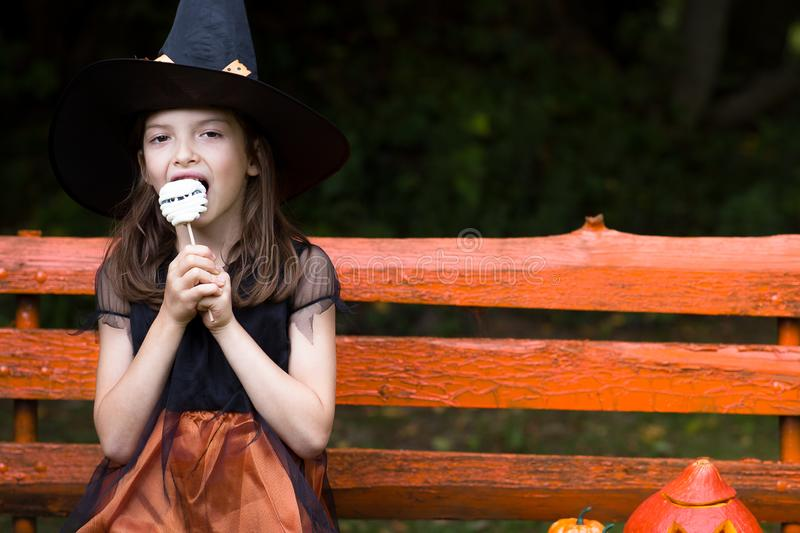 Portrait of a seven-year-old girl in a witch costume royalty free stock image