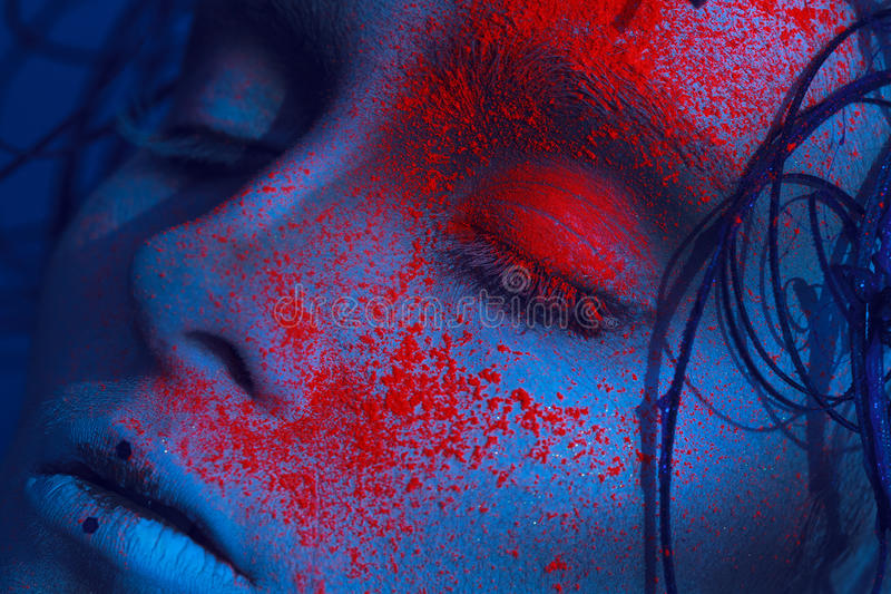 Portrait of adult girl with neon powder on face royalty free stock photos