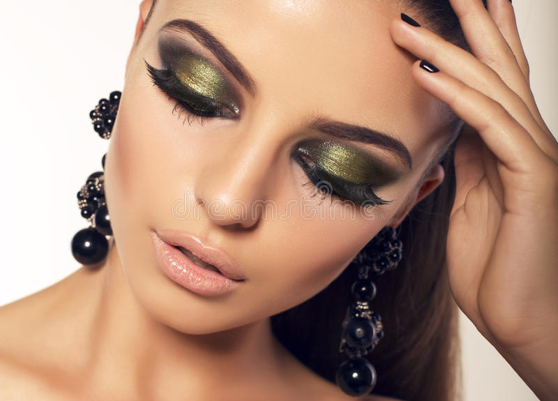 Portrait of beautiful brunette with smokey eyes makeup stock images