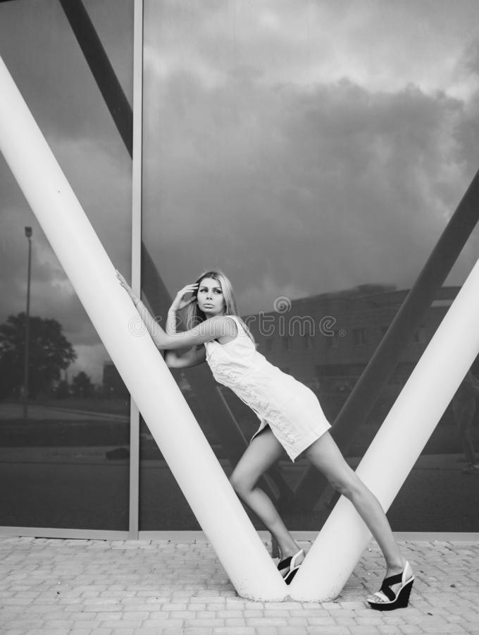 Blonde woman with long legs stock photos