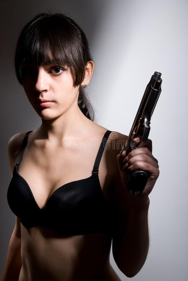 Portrait of a girl with a gun royalty free stock photo
