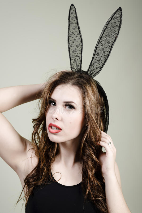 Portrait of mysterious young pretty lady and bunny ears mask. Mysterious young pretty lady and bunny ears mask, closeup portrait royalty free stock images