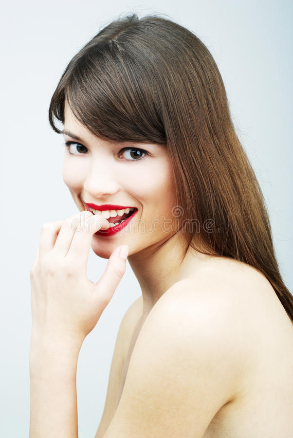 Download Portrait Of A Woman Biting Her Finger Stock Image - Image: 14850831