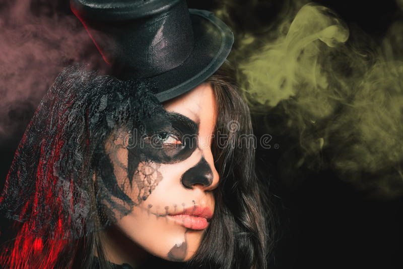 Portrait of woman with gothic makeup smokey eyes. Vampire, evil. Goth. Horror. Secret. Fashion. Venetian carnival. Hot babe. Halloween party stock photos