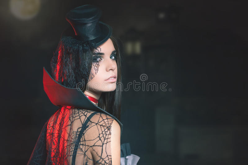 Portrait of woman with gothic makeup smokey eyes. Vampire, evil. Goth. Horror. Secret. Fashion. Venetian carnival. Hot babe. Halloween party masquerade stock photography