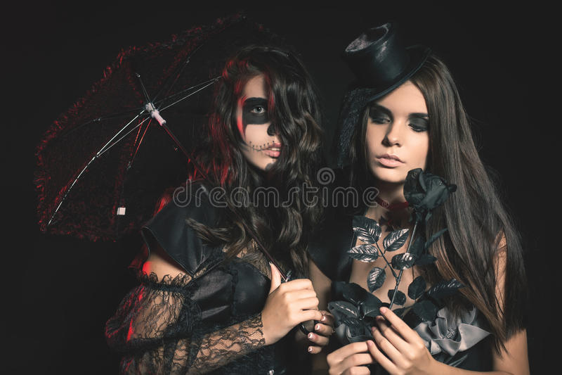 Portrait of women with gothic makeup smokey eyes. Halloween party masquerade. Portrait of women with gothic makeup smokey eyes. Holding a pumpkin. Vampire, evil stock photos