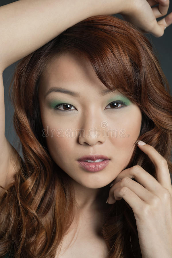 Portrait of young Chinese woman with eye shadow stock image