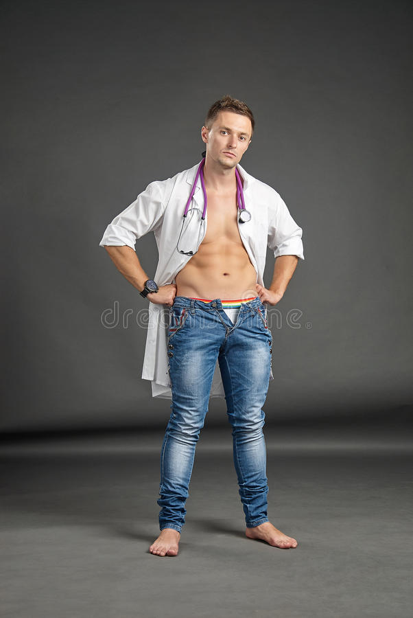Portrait of a young man in doctor costume royalty free stock photos