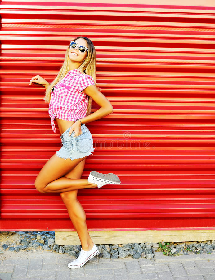 Portrait of young stylish smiling woman girl model in brigh stock photo