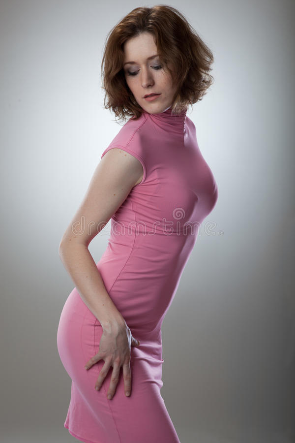 Portrait of young woman in pink dress stock image