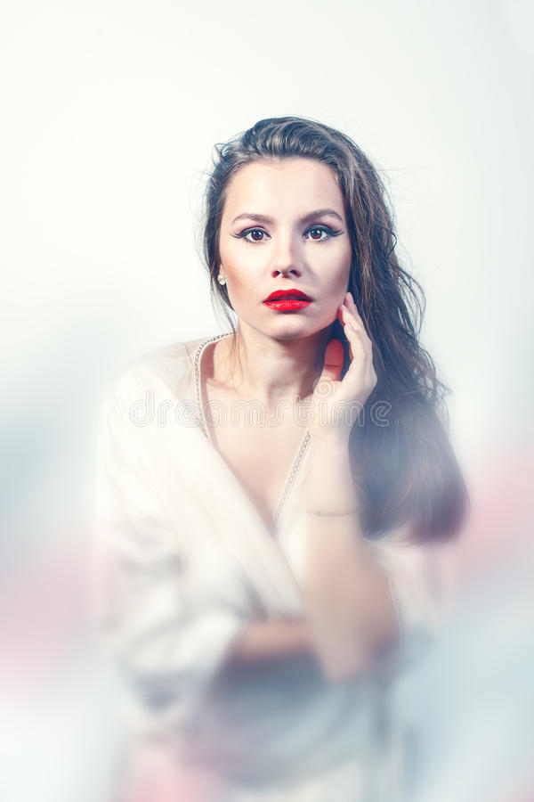Portrait of a young woman with red lips stock images