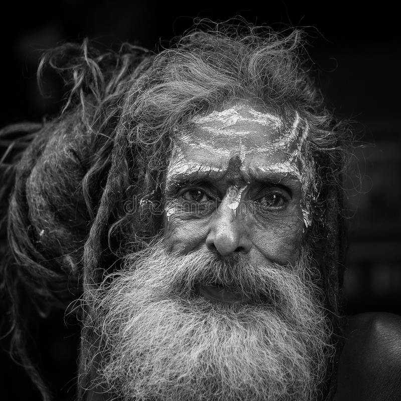 Portrait of Shaiva sadhu, holy man in Pashupatinath Temple, Kathmandu. Nepal . Black and white stock images