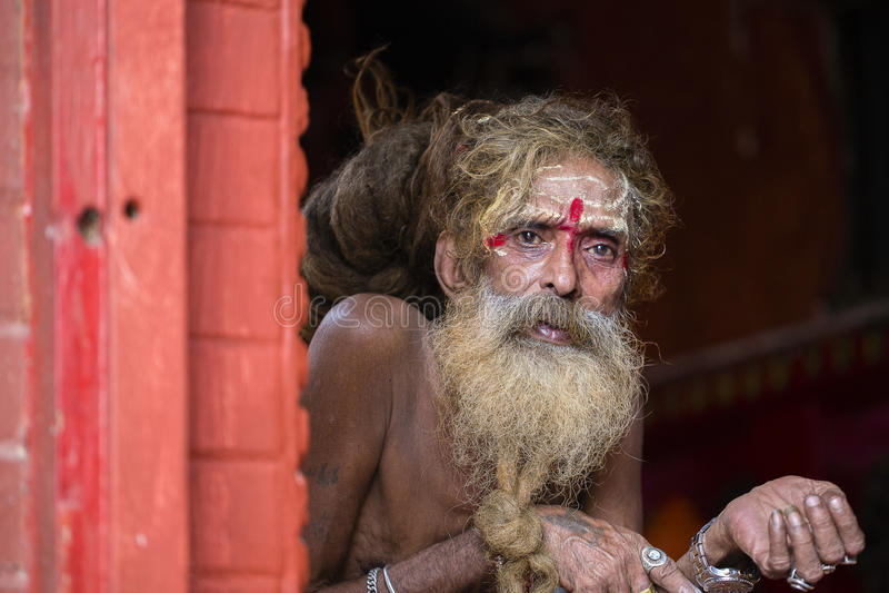 Portrait of Shaiva sadhu, holy man in Pashupatinath Temple, Kathmandu. Nepal. KATHMANDU, NEPAL - SEPTEMBER 29, 2016 : Portrait of Shaiva sadhu, holy man in stock photography