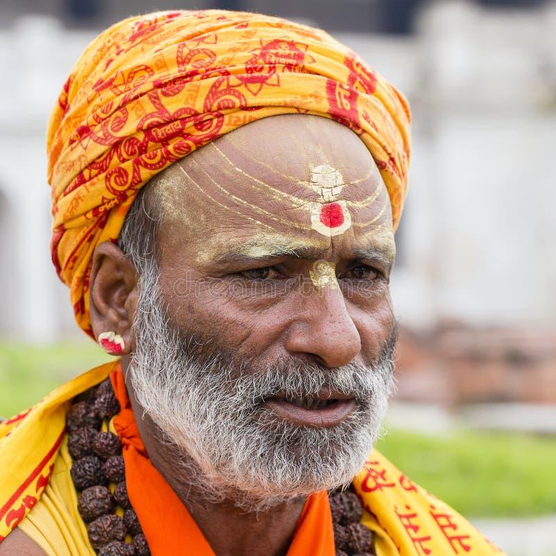 Portrait of Shaiva sadhu, holy man in Pashupatinath Temple, Kathmandu. Nepal. KATHMANDU, NEPAL - SEPTEMBER 29, 2016 : Portrait of Shaiva sadhu, holy man in royalty free stock photos