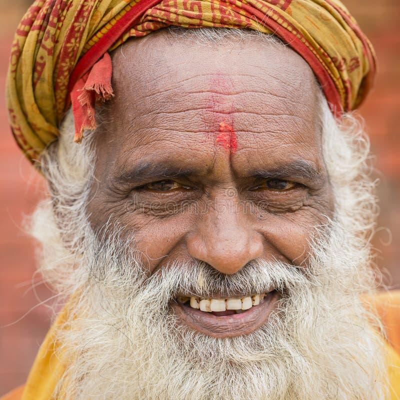 Portrait of Shaiva sadhu, holy man in Pashupatinath Temple, Kathmandu. Nepal. KATHMANDU, NEPAL - SEPTEMBER 29, 2016 : Portrait of Shaiva sadhu, holy man in royalty free stock photo