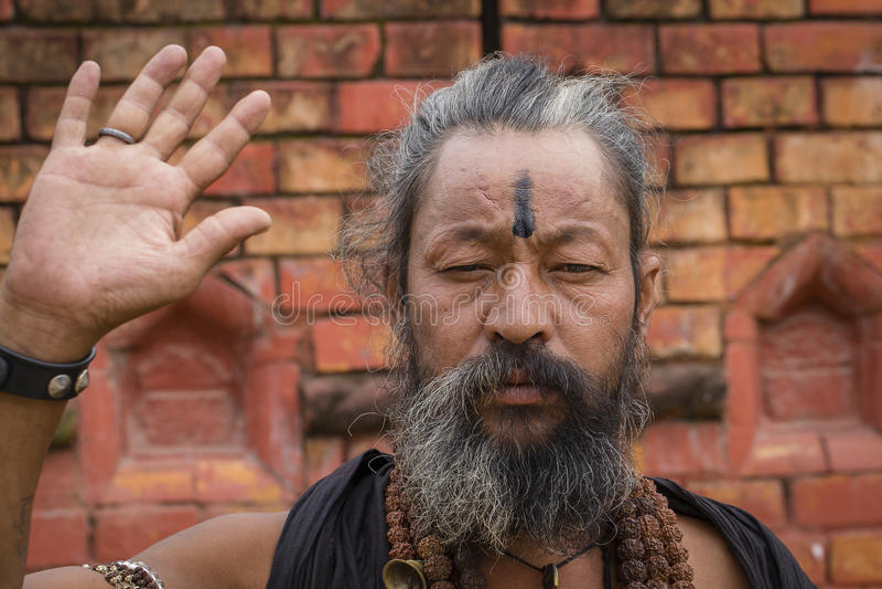 Portrait of Shaiva sadhu, holy man in Pashupatinath Temple, Kathmandu. Nepal royalty free stock image