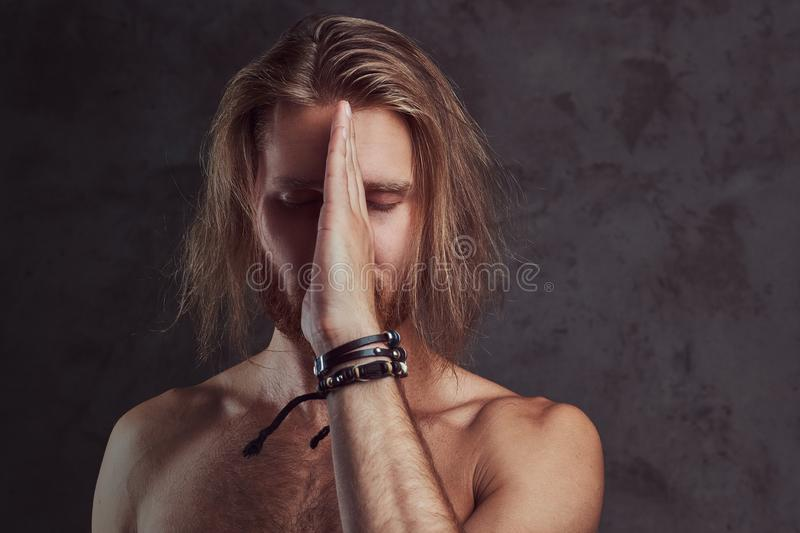 Portrait of shirtless redhead handsome man, isolated on dark background. stock photos