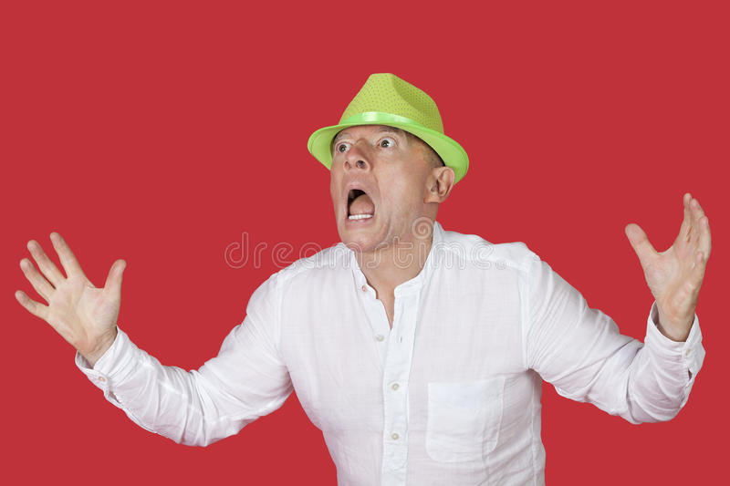 Portrait Of An Shocked Man Screaming Against Red Background Stock Image