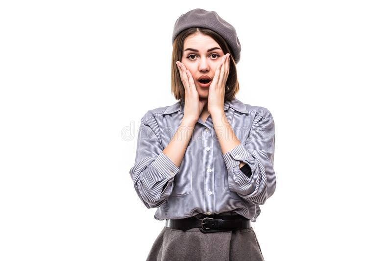 Portrait of a shocked woman dressed in beret screaming and looking away isolated over white background stock photos