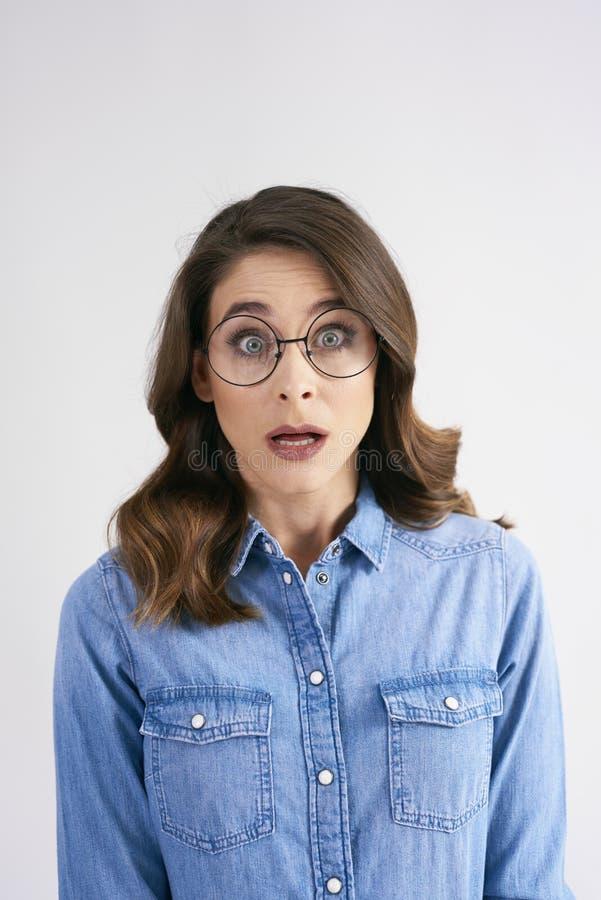 Portrait of shocked woman at studio shot royalty free stock photos