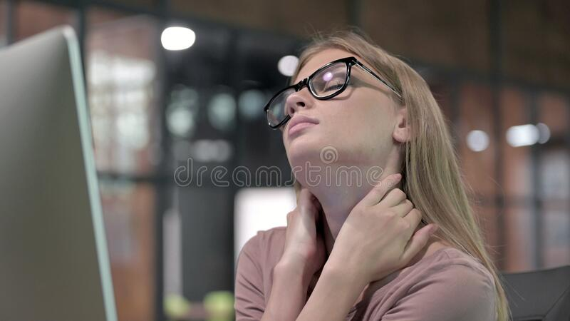 Portrait Shoot of Tired Woman Working and having Neck Pain stock photo