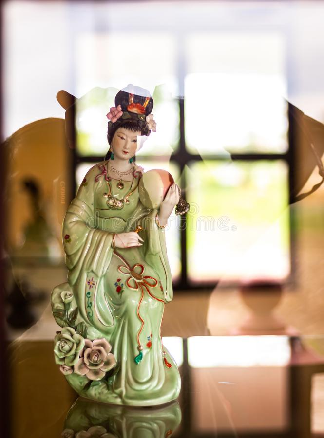 Portrait shot of Chang'e the lunar goddess in Chinese mythology from across a glass window. Mythology concept stock photography