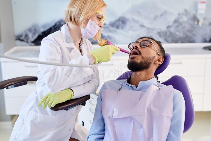 Undergoing Teeth Polishing stock images