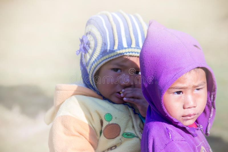 Portrait shot of kids. A beautiful portrait shot of two young childs of Nepali village stock images