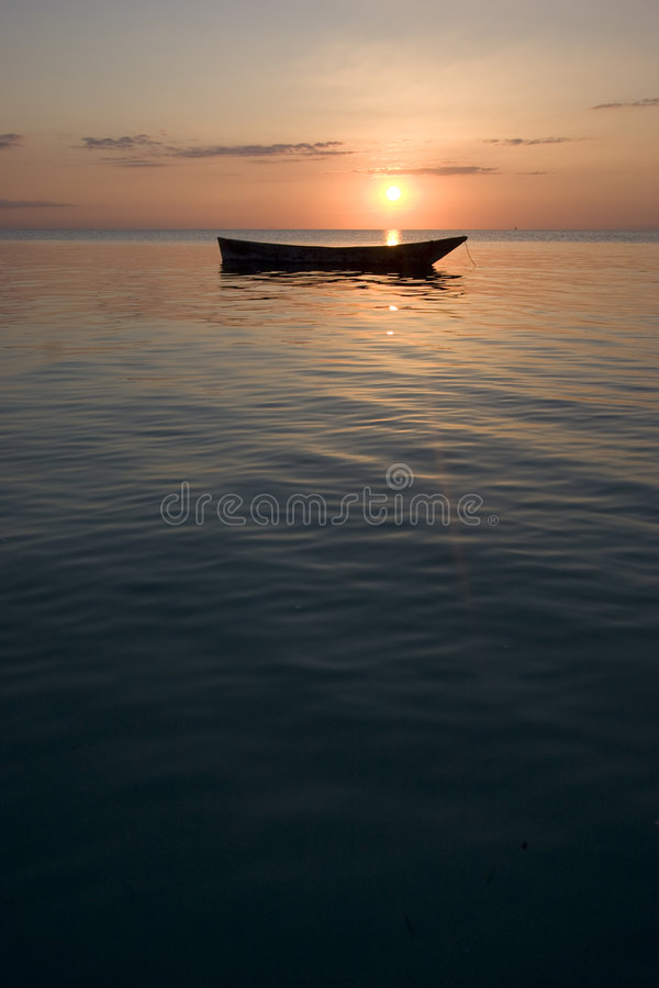 Portrait shot of row boat at sunset in africa zanz royalty free stock images