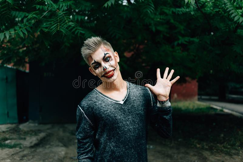 Portrait of laughing man with a make-up royalty free stock photo