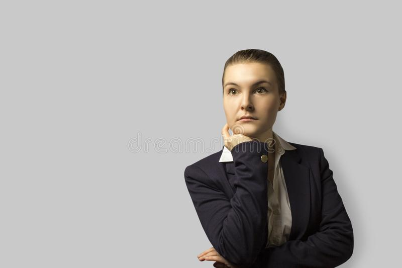 Portrait shot. young beautiful business woman with short hair combed back, wearing a jacket. with a serious face stock photo