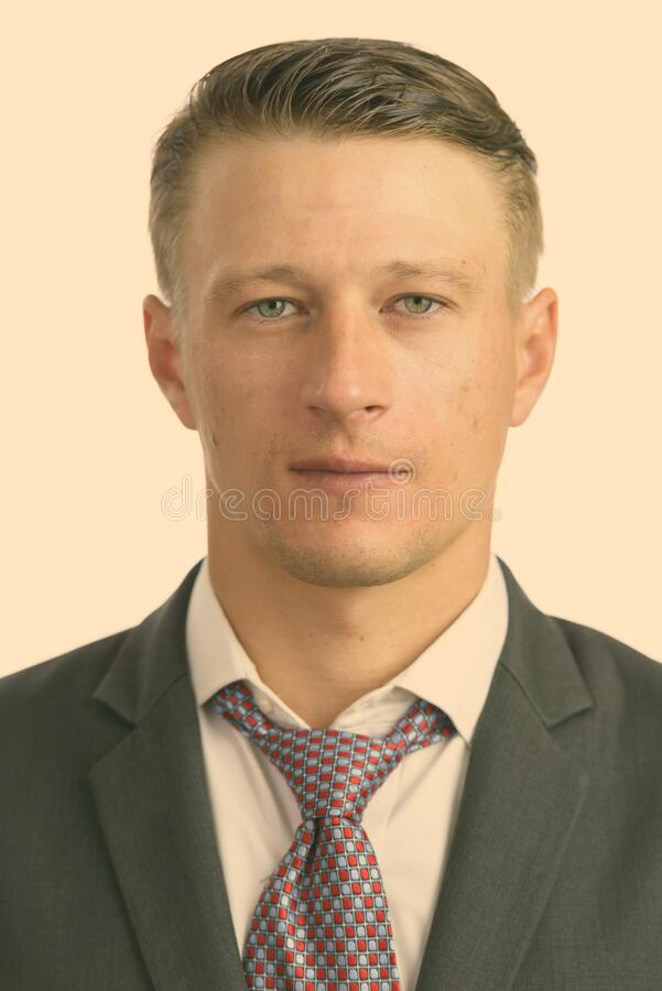 Portrait shot of young handsome Caucasian businessman isolated against white background royalty free stock photo